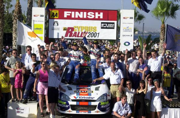 2001 World Rally ChampionshipCyprus Rally June 1-3, 2001Ford Team celebrate victory on the podiumPhoto: Ralph Hardwick/LAT