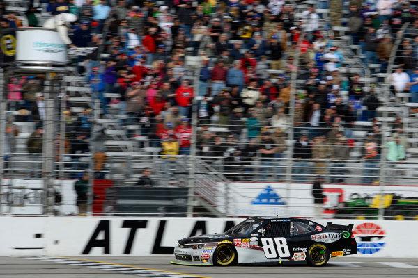 27-28 February 2015, Hampton, Georgia USA Kevin Harvick drives under the checkered flag to win ?2015, John Harrelson LAT Photo USA