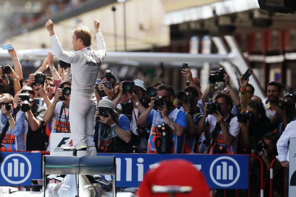 Circuit de Catalunya, Barcelona, Spain. Sunday 10 May 2015. Nico Rosberg, Mercedes F1 W06 Hybrid celebates in Parc Feme after winning the race. World Copyright: Alastair Staley/LAT Photographic. ref: Digital Image _79P0553