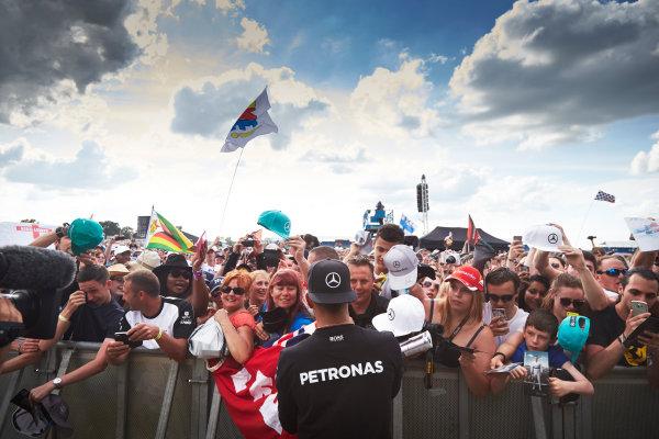 Silverstone Circuit, Northamptonshire, England. Saturday 4 July 2015. Lewis Hamilton, Mercedes AMG, signs autographs for fans. World Copyright: Steve Etherington/LAT Photographic ref: Digital Image SNE18923