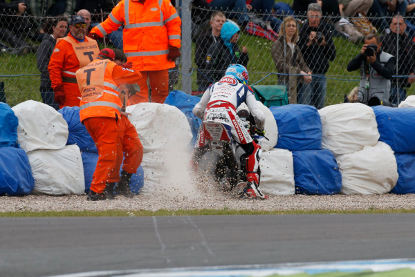 2015 World Superbike Championship.  Donington Park, UK.  23rd - 24th May 2015.  Marshals pelted by flying gravel as Michael van der Mark, Pata Honda, restarts after crashing at the Esses.  Ref: KW7_5931a. World copyright: Kevin Wood/LAT Photographic