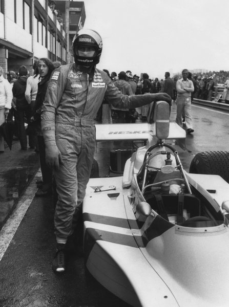 Zandvoort, Holland. 20 - 22 June 1975. James Hunt (Hesketh 308-Ford), 1st position,  in the pits before the race, portrait.  World Copyright: LAT Photographic. Ref:  B/W Print.