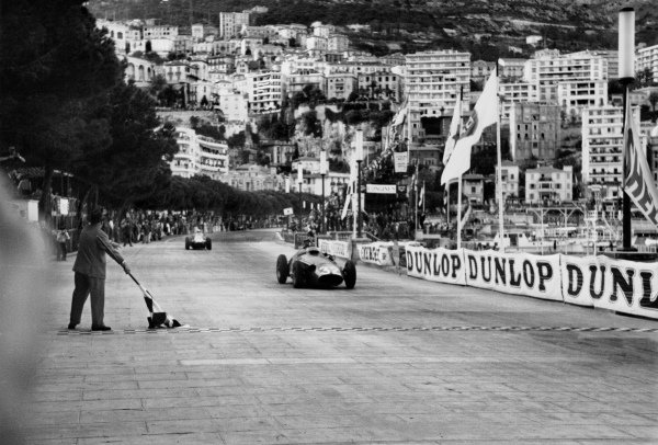 Monte Carlo, Monaco. 19 May 1957.Juan Manuel Fangio (Maserati 250F), 1st position, takes the chequered flag, action.World Copyright: LAT Photographic.Ref: B/WPRINT.