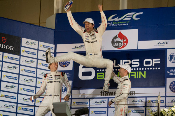 2015 WEC Bahrain International Circuit, Bahrain Saturday 21 November 2015. Mark Webber, Timo Bernhard and Brendon Hartley (#17 Porsche 919 Hybrid) celebrate on the podium after winning the drivers' championship. Photo: Sam Bloxham/LAT ref: Digital Image _SBL5902