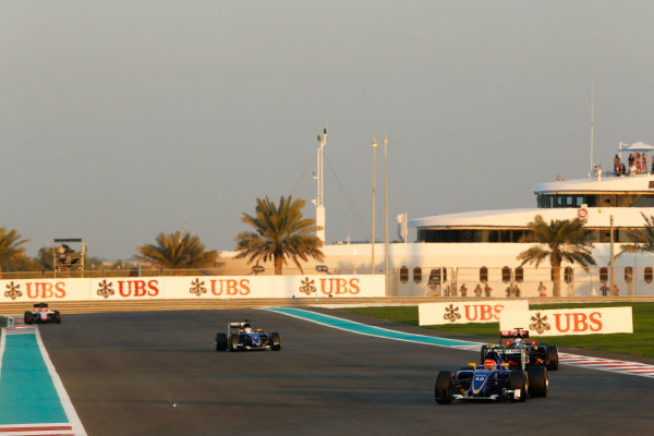 Yas Marina Circuit, Abu Dhabi, United Arab Emirates. Sunday 29 November 2015. Felipe Nasr, Sauber C34 Ferrari, leads Romain Grosjean, Lotus E23 Mercedes, and Marcus Ericsson, Sauber C34 Ferrari. World Copyright: Charles Coates/LAT Photographic ref: Digital Image _99O1903