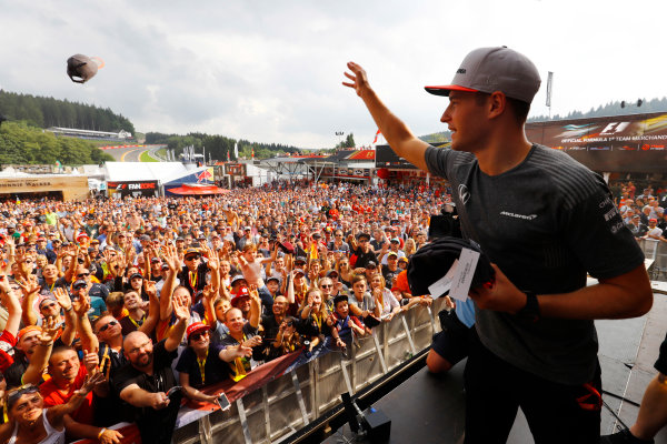 Spa Francorchamps, Belgium.  Saturday 26 August 2017. Stoffel Vandoorne, McLaren, throws hats in to the crowd from the F1 Fanzone stage. World Copyright: Steven Tee/LAT Images  ref: Digital Image _R3I0483