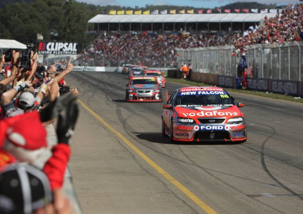 The Triple Eight Racing V8 Supercar of Jamie Whincup crosses the finish line to win the Clipsal 500, Round 01 of the Australian V8 Supercar Championship Series at the Adelaide Street Circuit, Adelaide, South Australia, February 24, 2008.