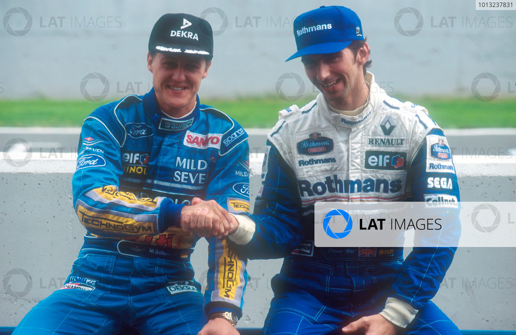 Jerez, Spain.14-16 October 1994.Michael Schumacher (Benetton Ford) gives arch rival Damon Hill (Williams Renault) a sportsman like handshake.Ref-94 EUR 15.World Copyright - LAT Photographic