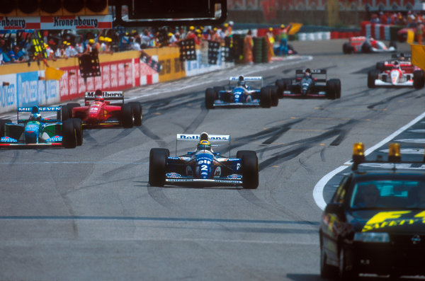 Imola, Italy.29/4-1/5 1994.Ayrton Senna (Williams FW16 Renault) leads the rest of the field behind the safety car which was brought out after the Lehto/Lamy startline shunt.Ref-94 SM 10.World Copyright - LAT Photographic