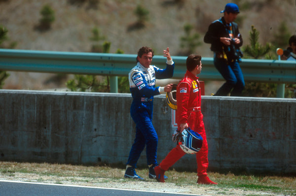 Tanaka International, Aida, Japan.15-17 April 1994.Ayrton Senna (Williams FW16 Renault) and Nicola Larini (Ferrari 412T1) walk back after ending up in the gravel together at the first corner. Senna had been helped into a spin by Hakkinen which left Larini no where to go.Ref-94 PAC 06.World Copyright - LAT Photographic