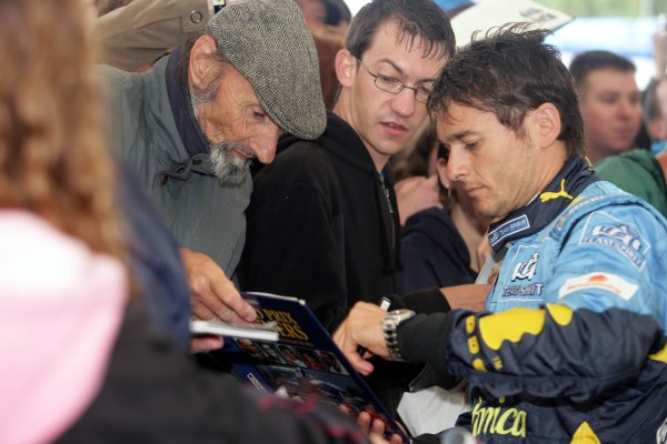 2006 Goodwood Festival of Speed.Goodwood Estate, West Sussex. 7th - 9th July 2006.Giancarlo Fisichella signs a book.World Copyright: Gary Hawkins/LAT Photographic.ref: Digital Image Only.
