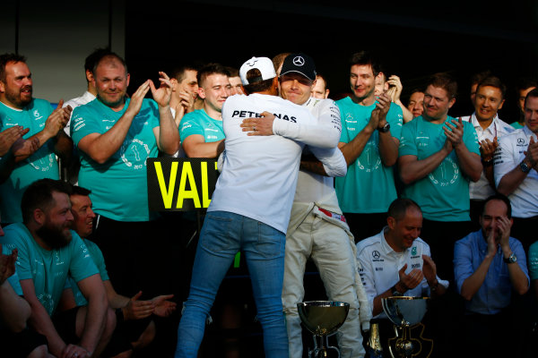 Sochi Autodrom, Sochi, Russia. Sunday 30 April 2017. Valtteri Bottas, Mercedes AMG, is congratulated on vicotory by Lewis Hamilton, Mercedes AMG. World Copyright: Andy Hone/LAT Images ref: Digital Image _ONZ2513