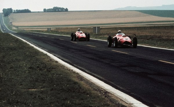 A slightly damaged Phil Hill (USA) Ferrari D246 leads team mate Wolfgang von Trips (GER) through the French countryside. French Grand Prix, Reims, France, 3 July 1960.