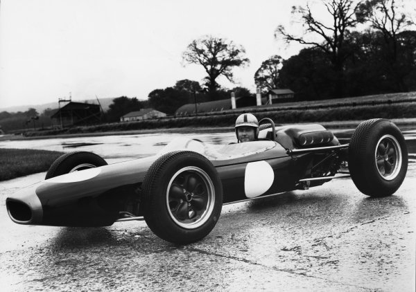 Chessington, Surrey. Jack Brabham sits in the new Brabham-Repco BT11, portrait.World Copyright: LAT Photographic.Ref:  B/W Print.