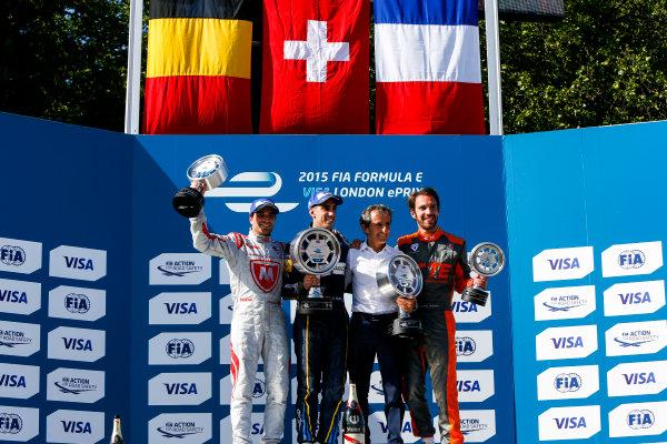 2014/2015 FIA Formula E Championship. London e-Prix, Battersea Park, London, UK. Saturday 27 June 2015. Sebastien Buemi (SWI)/E.dams Renault - Spark-Renault SRT_01E, Jerome D'Ambrosio (BEL)/Dragon Racing - Spark-Renault SRT_01E, nd Jean-Eric Vergne (FRA)/Andretti Motorsport - Spark-Renault SRT_01E on the podium. World Copyright: Zak Mauger/LAT Photographic/Formula E. ref: Digital Image _L0U9210
