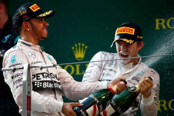 Shanghai International Circuit, Shanghai, China. Sunday 12 April 2015. Lewis Hamilton, Mercedes AMG, 1st Position, and Nico Rosberg, Mercedes AMG, 2nd Position, spray Champagne on the podium. World Copyright: Andrew Hone/LAT Photographic. ref: Digital Image _ONZ1327