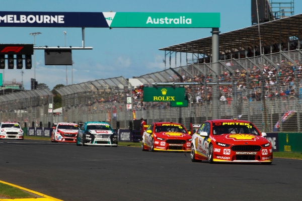 Scott McLaughlin, DJR Team Penske Ford, leads Fabian Coulthard, DJR Team Penske Ford, and Michael Caruso, Nissan Motorsport Nissan.