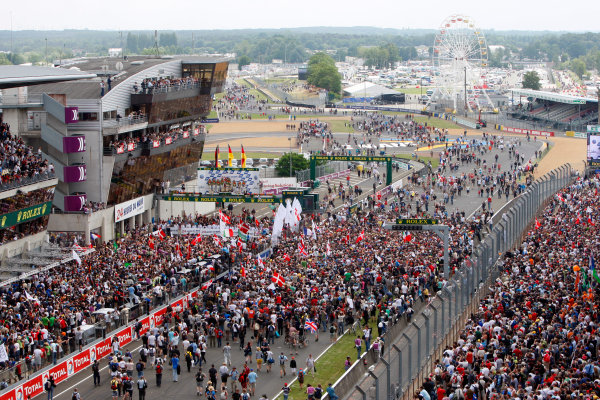 Circuit de La Sarthe, Le Mans, France. 6th - 13th June 2010.A huge crowd forms beneath the podium to celebrate a clean sweep for Audi with Mike Rockenfeller / Timo Bernhard / Romain Dumas, Audi Sport North America, No 9 Audi R15-Plus TDI, 1st position, Andre Lotterer / Marcel Fassler / Benoit Treluyer, Audi Sport Team Joest, No 8 Audi R15-Plus TDI, 2nd position, and Tom Kristensen / Dindo Capello / Allan McNish, Audi Sport Team Joest, No 7 Audi R15-Plus TDI, 3rd position. Portrait. Podium.World Copyright: Alastair Staley/LAT PhotographicDigital Image _O9T1020 jpg
