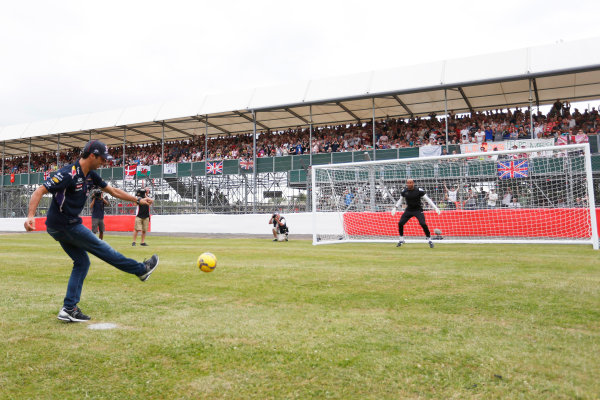Silverstone, Northamptonshire, England. Thursday 3 July 2014. Daniel Ricciardo, Red Bull Racing, takes some penalty kicks as part of a feature for Sky Sports F1. World Copyright: Andrew Ferraro/LAT Photographic. ref: Digital Image _FER9766