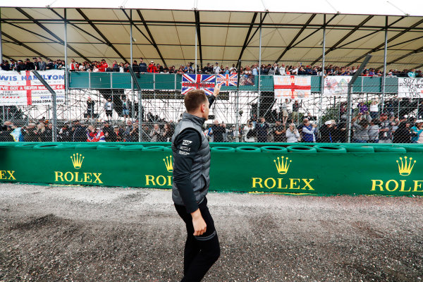 Silverstone, Northamptonshire, UK.  Thursday 13 July 2017. Stoffel Vandoorne, McLaren, waves to fans in a grandstand. World Copyright: Glenn Dunbar/LAT Images  ref: Digital Image _X4I2929
