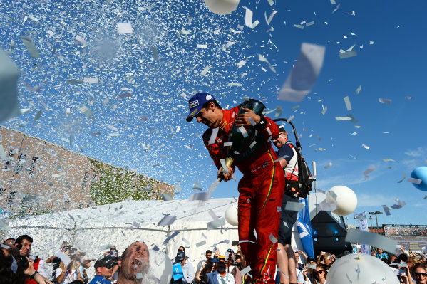 2016/2017 FIA Formula E Championship. Round 12 - Montreal ePrix, Canada Sunday 30 July 2017. Lucas Di Grassi (BRA), ABT Schaeffler Audi Sport, Spark-Abt Sportsline, ABT Schaeffler FE02, sprays the champagne on the podium. Photo: Patrik Lundin/LAT/Formula E ref: Digital Image PL1_3783 copy