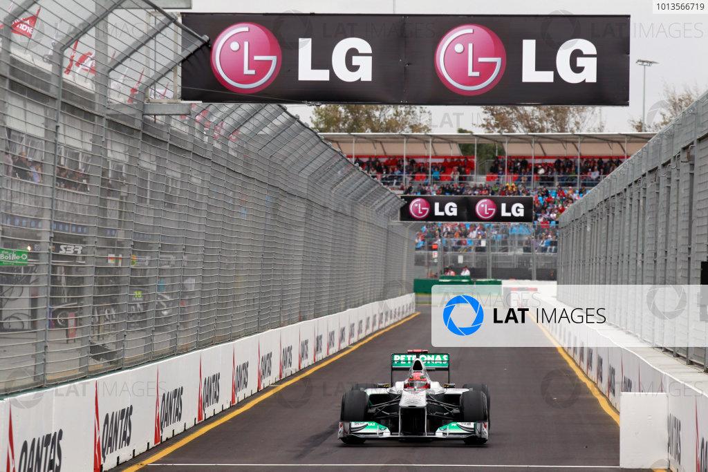 Albert Park, Melbourne, Australia25th March 2011.Michael Schumacher, Mercedes GP W02, enters the pit lane. Action. World Copyright: Charles Coates/LAT Photographicref: Digital Image _X5J8806