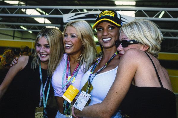 Gail Porter, Melinda Messenger and Jordan in the Jordan Grand Prix garage.