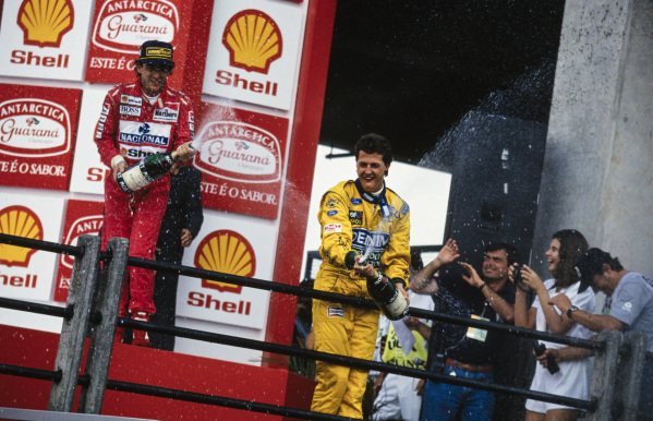 Ayrton Senna, 1st position, and Michael Schumacher, 3rd position, celebrate on the podium.