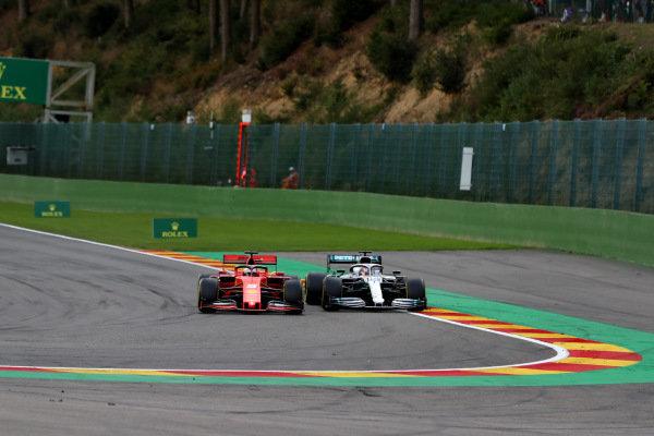 Sebastian Vettel, Ferrari SF90, leads Lewis Hamilton, Mercedes AMG F1 W10