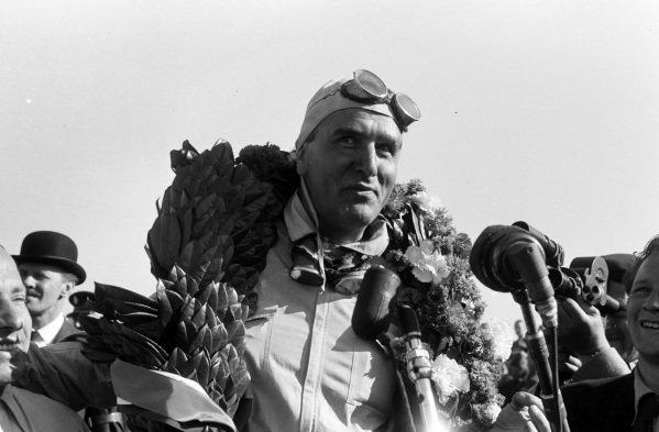 Giuseppe Farina with his winner's garland around his neck.