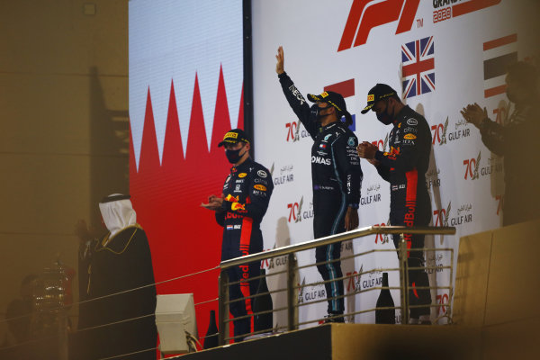 Max Verstappen, Red Bull Racing, 2nd position, Lewis Hamilton, Mercedes-AMG Petronas F1, 1st position, and Alexander Albon, Red Bull Racing, 3rd position, on the podium
