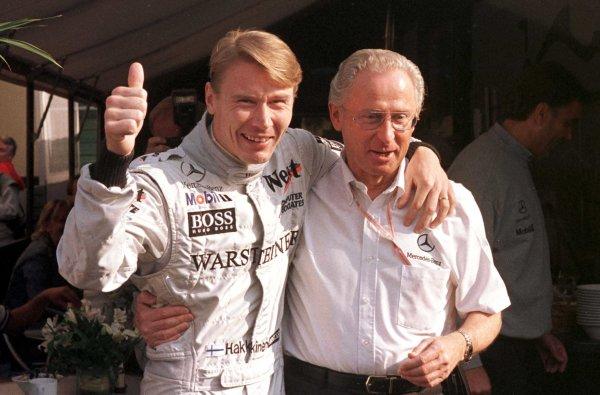 1998 San Marino Grand Prix.Imola, Italy.24-26 April 1998.Mika Hakkinen (McLaren Mercedes-Benz) celebrates his 100th F1 GP with Faimler-Benz Boss Dr Jurgen Hubert.World Copyright - Tee/LAT Photographic