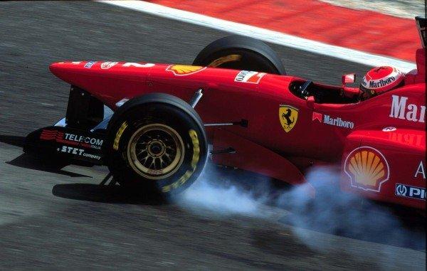 1996 Portuguese Grand Prix.Estoril, Portugal.20-22 September 1996.Eddie Irvine (Ferrari F310) locking up under braking.World Copyright - LAT Photographic