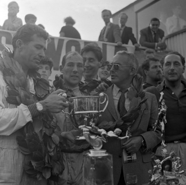 The winning David Brown entry of Carroll Shelby, Jack Fairman and Stirling Moss celebrates victory.