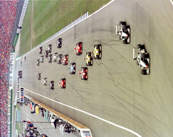 1998 German Grand Prix.Hockenheim, Germany.31/7-2/8 1998.Mika Hakkinen (McLaren MP4/13 Mercedes-Benz) leads at the start. He finished in 1st position.World Copyright - Steve Etherington/LAT Photographic