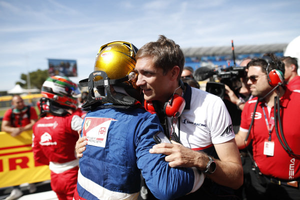 Robert Shwartzman (RUS) PREMA Racing, is congratulated by Vitaly Petrov in parc ferme