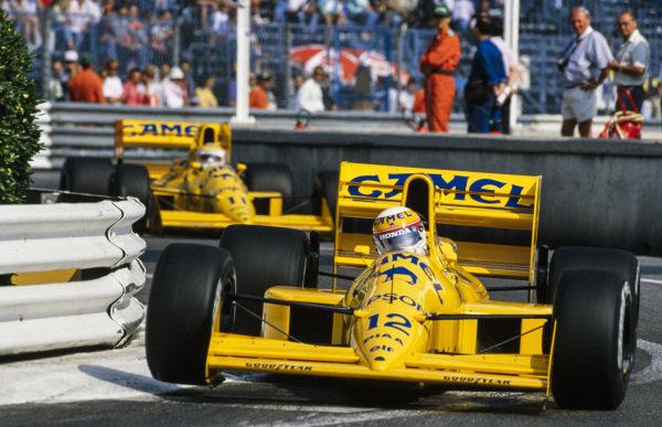 Satoru Nakajima, Lotus 101 Judd, leads Nelson Piquet, Lotus 101 Judd.