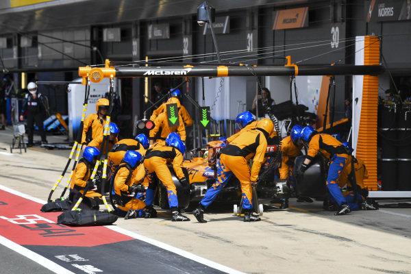 Lando Norris, McLaren MCL34, makes a stop