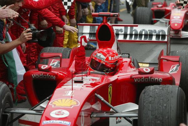2004 Australian Grand Prix - Sunday Race, Albert Park, Melbourne. Australia. 7th March 2004Michael Schumacher, Ferrari F2004 enters parc ferme. World Copyright: Steve Etherington/LAT Photographic ref: Digital Image Only