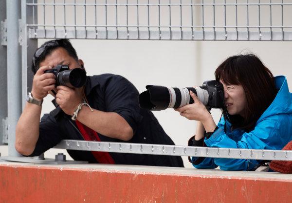 Korea International Circuit, Yeongam-Gun,South Korea. 16th October 2011. Photographers. Atmosphere.  World Copyright:Steve Etherington/LAT Photographic ref: Digital Image SNE20466
