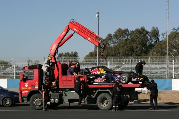 The car of Sebastian Vettel (GER) Red Bull Racing RB4 is taken back to the pits after he went off.