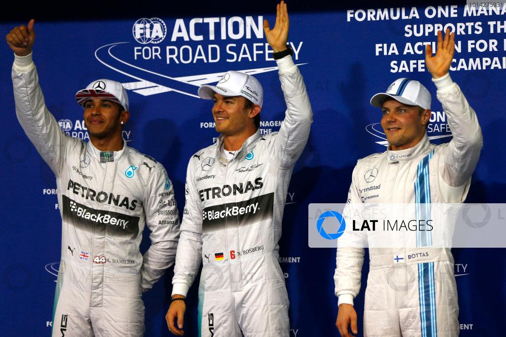 Yas Marina Circuit, Abu Dhabi, United Arab Emirates. Saturday 22 November 2014. Top three qualifiers Nico Rosberg, Mercedes AMG, Lewis Hamilton, Mercedes AMG, and Valtteri Bottas, Williams F1. World Copyright: Andy Hone/LAT Photographic. ref: Digital Image _ONY0826