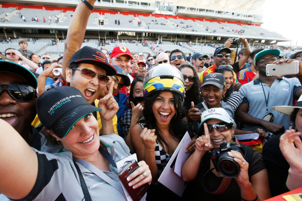 Circuit of the Americas, Austin, Texas, United States of America. Sunday 2 November 2014. Fans celebrate after the race. World Copyright: Charles Coates/LAT Photographic. ref: Digital Image _J5R1457
