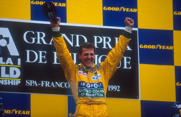 1992 Belgian Grand Prix.Spa-Francorchamps, Belgium.28-30 August 1992.Michael Schumacher (Benetton Ford) celebrates 1st position and his maiden Grand Prix win on the podium. World Copyright - LAT Photographic