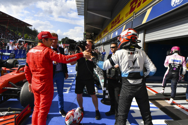 Charles Leclerc, Ferrari, is congratulated in parc ferme by Robert Kubica, Williams Racing