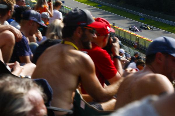 Daniel Ricciardo, Renault R.S.19, passes Sergio Perez, Racing Point RP19