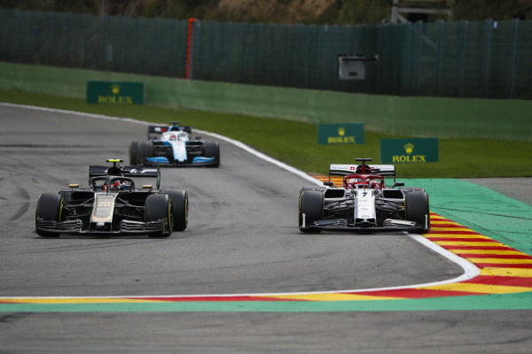 Kevin Magnussen, Haas VF-19, leads Kimi Raikkonen, Alfa Romeo Racing C38, and George Russell, Williams Racing FW42