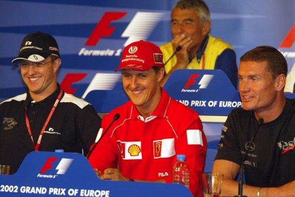 2002 European Grand Prix Grand Prix - PreviewNurburgring, Germany. 20th June 2002Ralf Schumacher (Williams BMW), Michael Schumacher (Ferrari) and David Coulthard (McLaren Mercedes) in a press conference.World Copyright: Steve Etherington/LATref: Digital Image Only