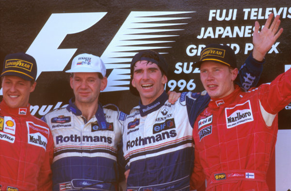 Suzuka, Japan.11-13 October 1996.Damon Hill (Williams Renault) 1st position with Adrian Newey (Williams), Michael Schumacher (Ferrari) 2nd position and Mika Hakkinen (McLaren Mercedes) 3rd position celebrate on the podium.Ref-96 JAP 07.World Copyright - LAT Photographic