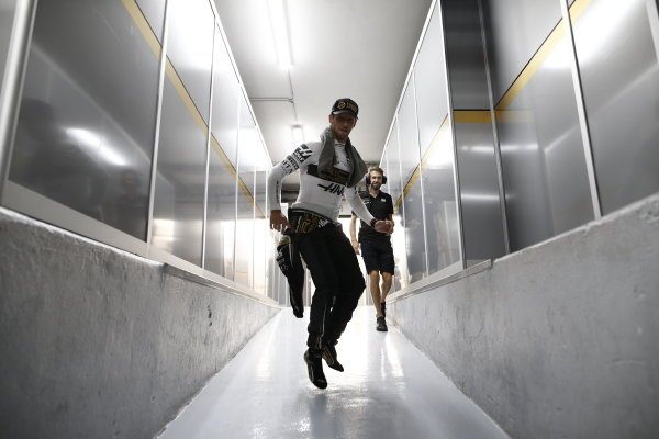 Romain Grosjean, Haas, walking through to the garage on Saturday afternoon